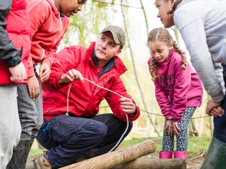 Adult leader teaching rope skills